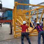 foin tower crane unloading at jobsite